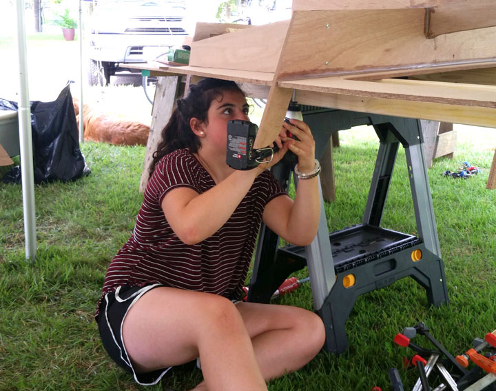 Alexandra assembling the frame.
